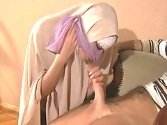 Hijabi Muslimah deep-throats sperm out of Biggest 10 inch Western Hard-on